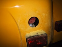 Nice neat hole cut for fuell filler cap. You can see the red plastic cover on the fuel tank filler neck (click for larger image)