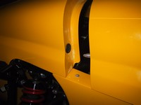 Shot of aluminium dowel on front return of bonnet which locates into grommet on nose cane (click for larger image)