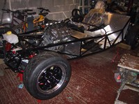 Engine bolted in, chassis back up on stands (click for larger image)