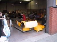 Chassis and bodywork wheeled out to doorway (click for larger image)